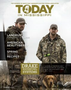 Today in Mississippi March 2020 issue cover. Drake waterfowl systems. Two men dressed in camo with a dog.